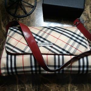 A vintage burberry purse never seen daylight